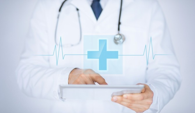male-doctor-holding-tablet-pc-with-medical-app